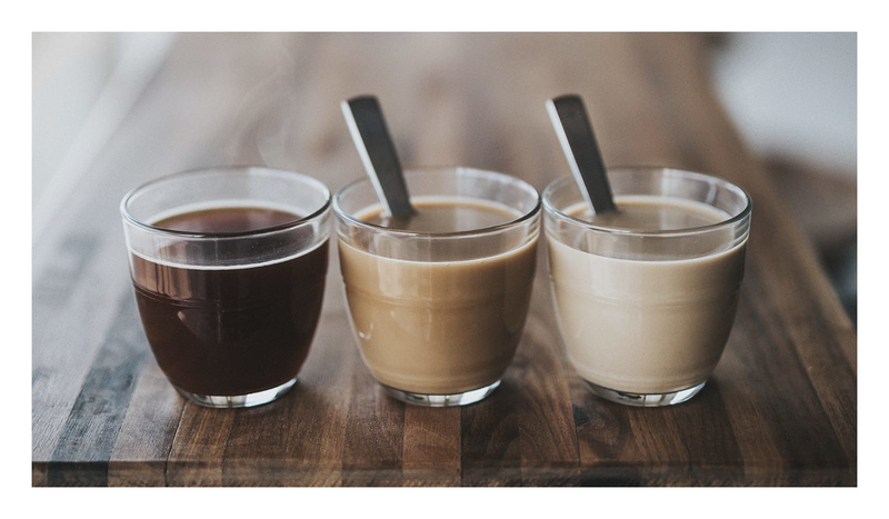 an image of three different cups of coffee, each with different shades