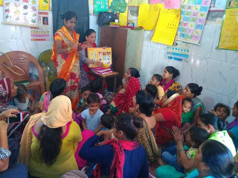 Poshan mitras with mothers of children under 5 years